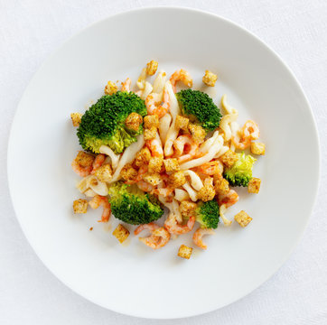 warm salad of broccoli and seafood with spicy croutons