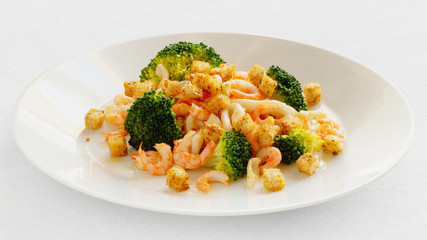 marinated in lemon juice seafood fried in garlic oil with steamed broccoli and croutons