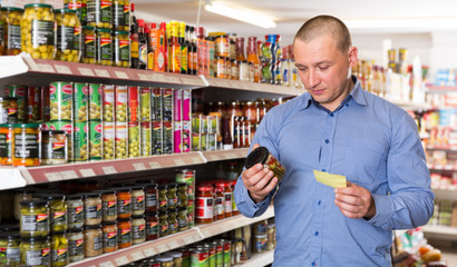 man buying food goods on shopping list