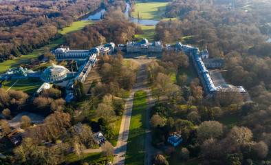 Beautiful Aerial View of Castle of Laeken palace, official royal family residence, around Royal Domain of Laeken park, feat. Orangery Greenhouse in Brussels Belgium