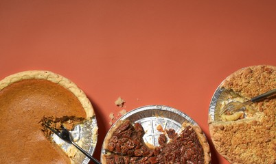 Close up of pie against orange background
