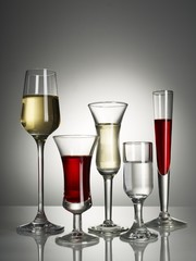 Wine glass served on table against gray background