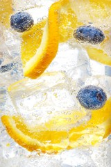 Close up of blueberry and sweet lime with ice served in glass