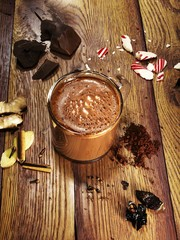 Chocolate drink with spices served on table