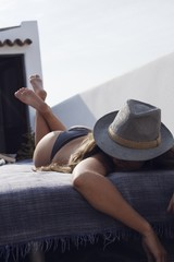 Woman lying on bed outdoors