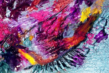 Close up of woman's eye with colorful makeup