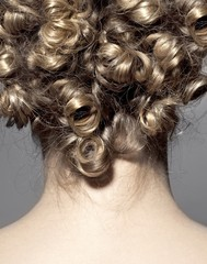 Rear view of woman with curly hair