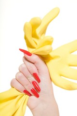 Close up of a woman's hand holding rubber glove
