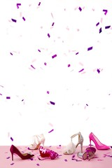 Shoes and confetti against white background