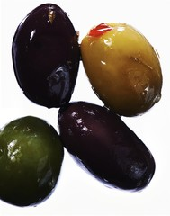 Close up of olives against white background