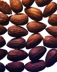 Close up of almonds against white background