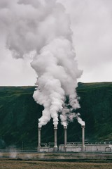 View of smoke emitting from geothermal generator in Iceland
