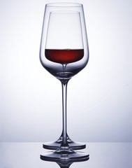 Wine served in wine glass against white background