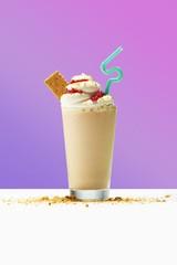 Milkshake on table against purple background
