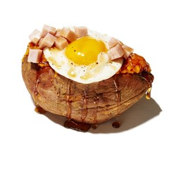 Close up of  bruschetta bread with fried egg and meat on white background