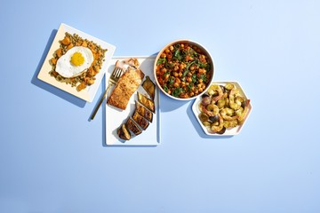 Varieties of food served on plate isolated on blue background