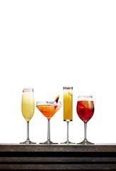 Varieties of drinks in glass against white background