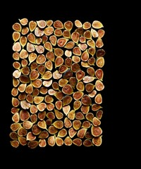 Overhead view of figs isolated on black background