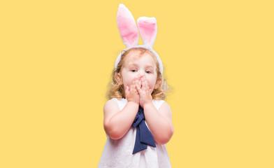 Lovely blonde toddler wearing easter bunny ears