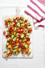 Overhead view of roasted fruit salad on cutting board