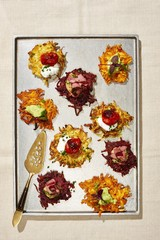 Overhead view of appetizers served in tray