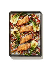 Miso glazed salmon and bok choy against white background