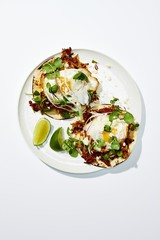 Egg tortilla served on plate on white background