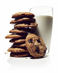 Stack of cookies with milk on white background