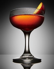 Cocktail with apple slice on gray background