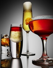 Varieties of drink served in glass on gray background