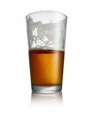 Half glass of beer isolated on white background