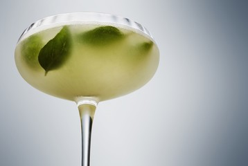 Close up of basil in drink served in martini glass