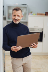 Man with tablet pc, standing at home