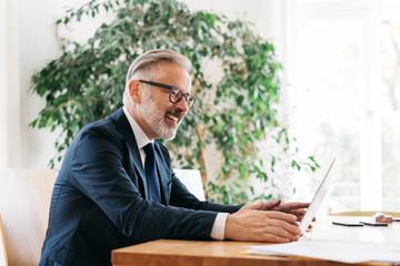 Pleased businessman reading good news
