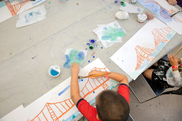 Children painting and drawing