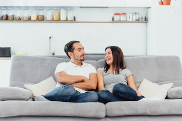 A woman and a man watch TV