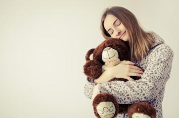Teen girl with teddy bear