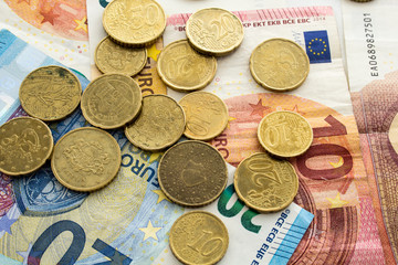 A pile of euro notes and coins