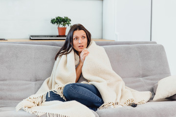 Woman looks TV