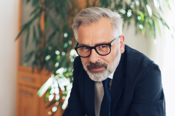 Bearded man in glasses and suit