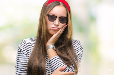 Young beautiful caucasian woman wearing sunglasses over isolated background thinking looking tired and bored with depression problems with crossed arms.
