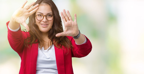 Beautiful plus size young business woman wearing elegant jacket and glasses over isolated background Smiling doing frame using hands palms and fingers, camera perspective