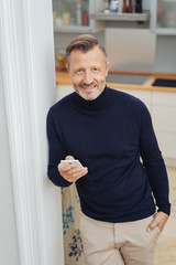 Man looking at camera with cellphone in his hand