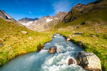 Fresh stream in river coming from glaciers up the valley near Neue Regensburger huette, Stubai Tyrol Alps, Austria