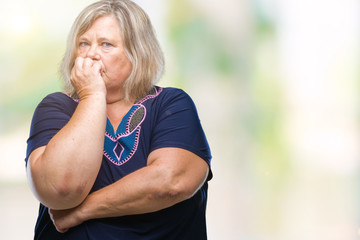 Senior plus size caucasian woman over isolated background looking stressed and nervous with hands on mouth biting nails. Anxiety problem.