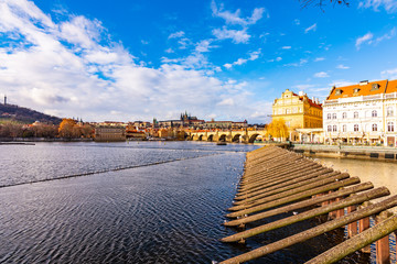 Prague, Czech republic: Look to Charles bridge and Prague castle in far. Sunny winter day near the Vltava river. Panorama view of Prague city, cityscape with Prague castle. Czech capital