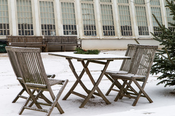 Garden furniture with snow