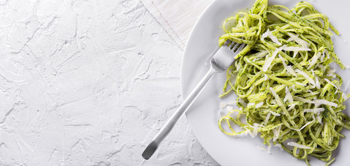 Linguine with genoese pesto. Top view, space for text