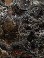 Texture of old vintage  stained glass gothic patterned window made of iron forged profile and rivets, cracked glass