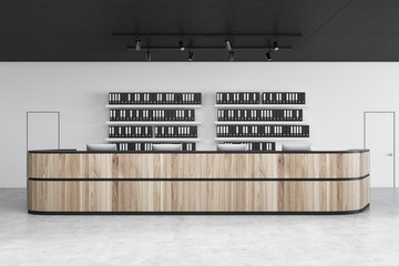 Wooden reception in white office